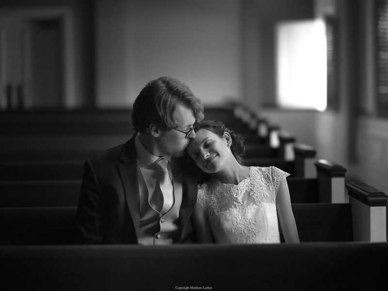 Married Christian couple in church pew